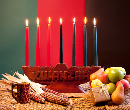 Traditional celebration of Kwanzaa with corns and fruits 153714451