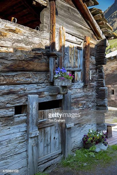 Traditional chalet in village of Zmutt in the Swiss Alps near Zermatt Switzerland