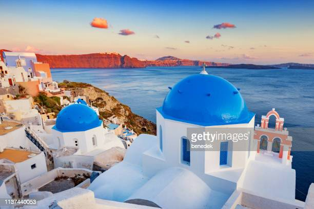 traditional chapels in oia santorini greece - caldera stock pictures, royalty-free photos & images