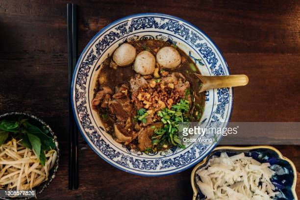 traditional chinese beef noodle soup - vietnamese culture stock pictures, royalty-free photos & images