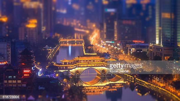 traditional chinese bridge in Chengdu at night ( Sichuan , China )