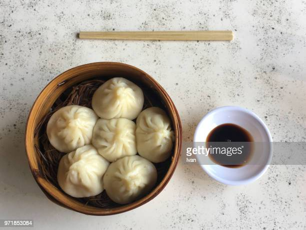 traditional chinese cuisine, steam-fried bao with chosticks - steamed stock pictures, royalty-free photos & images