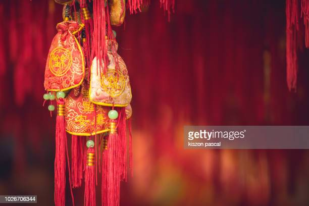 traditional chinese decoration sachets for lunar new year in china - chinese new year stock pictures, royalty-free photos & images