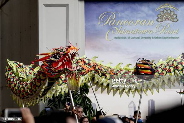 Traditional Chinese dragon Barongsai perform 'Lion Dance' during 'Cap Go Meh' festival that marks the end of the Chinese Lunar New Year celebration...