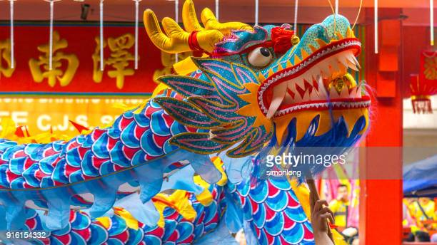 traditional chinese dragon dance in kuala lumpur,malaysia - animal representation stock pictures, royalty-free photos & images