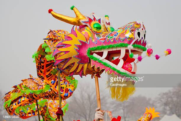 traditional chinese dragon dancing - chinese dragon stock photos and pictures
