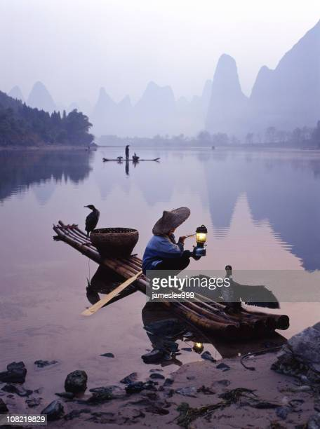 Traditional Chinese Fisherman on River