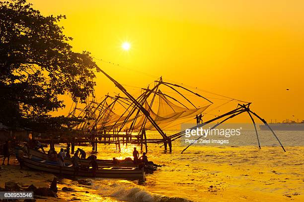 Traditional chinese fishing nets in Kochi, India at sunrise