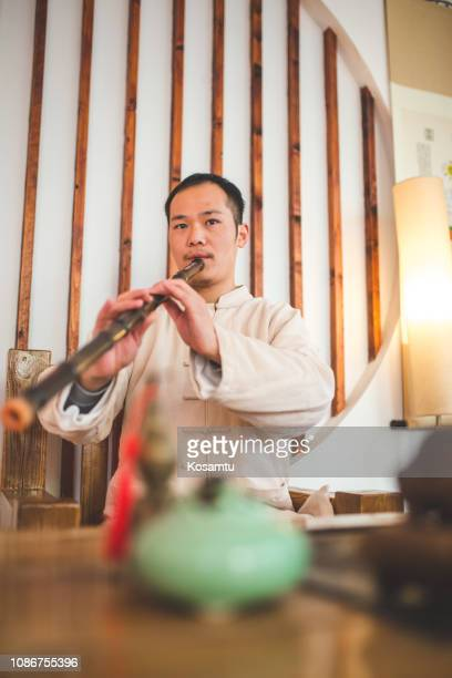 traditional chinese flautist - bamboo flute foto e immagini stock