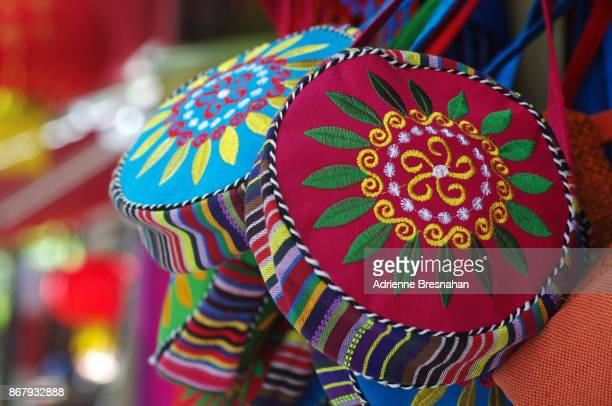traditional chinese naxi handicraft handbags, close-up - multi coloured purse stock photos and pictures