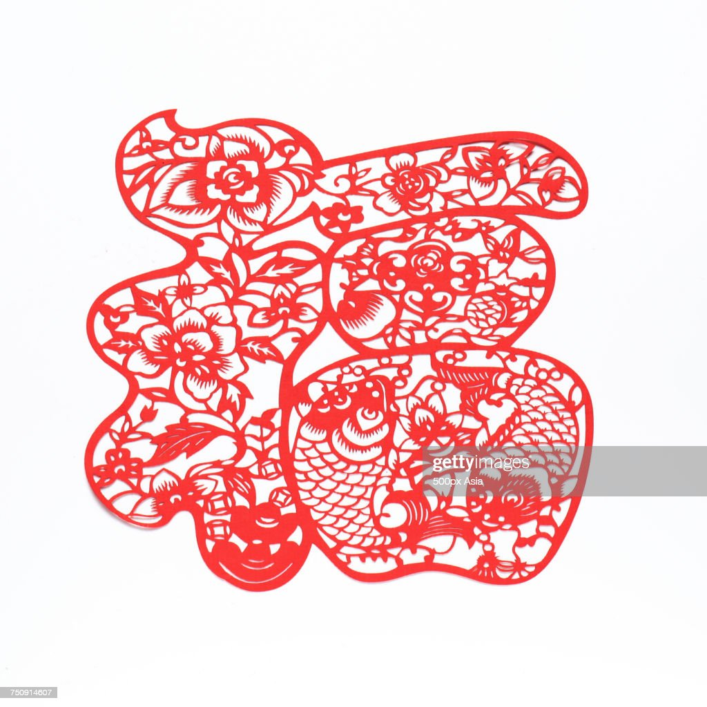 Traditional chinese paper cutting with fishes and lotus flowers traditional chinese paper cutting with fishes and lotus flowers stock photo mightylinksfo