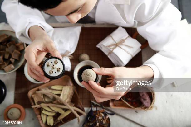 Traditional chinese physician holding moxibustion