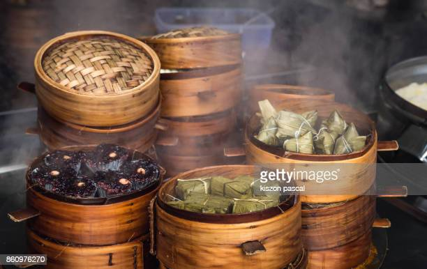 Traditional Chinese steamed food in bamboo steamers in a Market . .