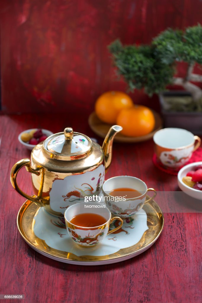 Traditional Chinese tea set and with tea on red table top.  Stock Photo & Traditional Chinese Tea Set And With Tea On Red Table Top Stock ...