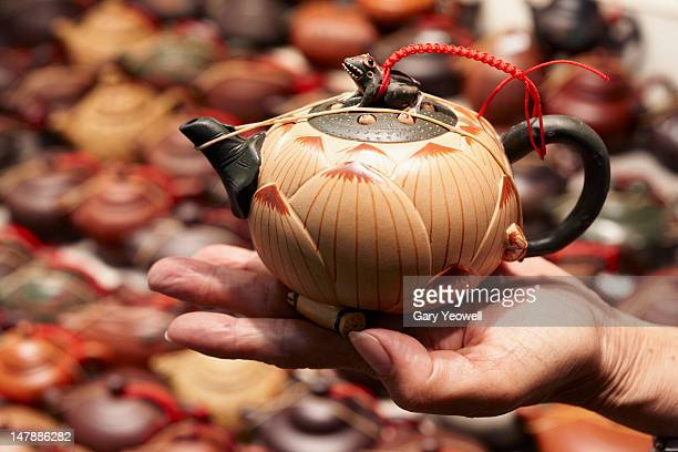 traditional chinese teapots on a market stall - yeowell stock photos and pictures