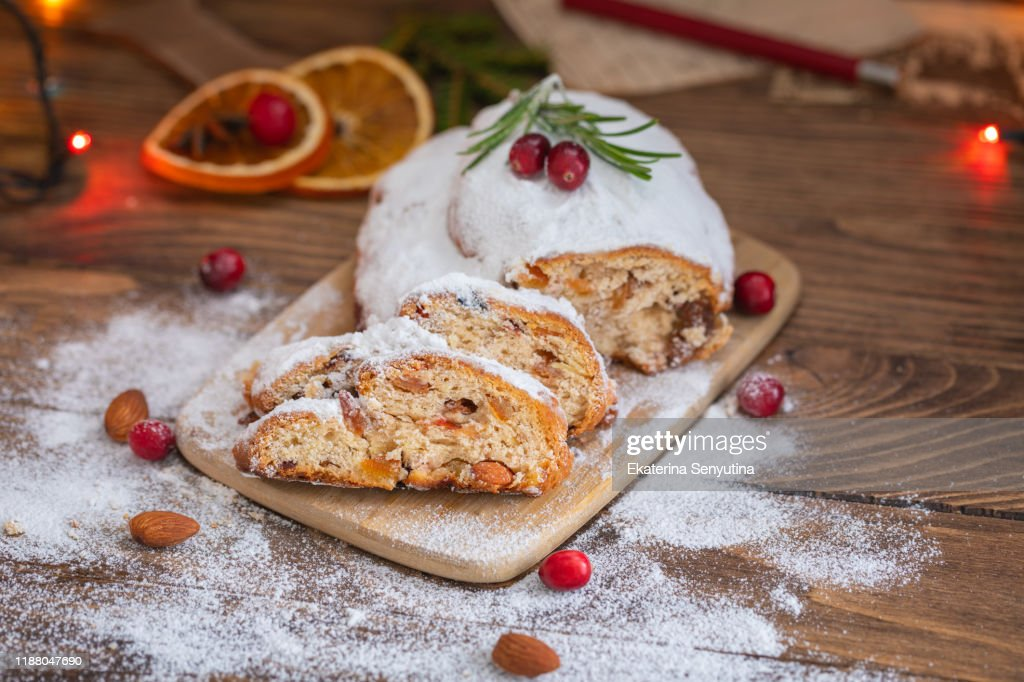 Traditional Christmas German cake Stollen with raisins and nuts, sliced : Stock Photo