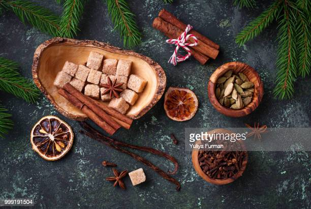 traditional christmas spices on green background. - christmas background stock photos and pictures