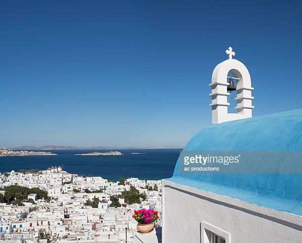 traditional church and mykonos cityscape, cyclades, greece - ver a hora stockfoto's en -beelden
