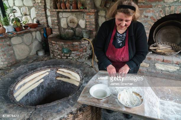 Traditional clay oven bread-maker, Numisi Wine Cellar, Velistsikhe, Kakheti, Georgia (Model and Property Release)
