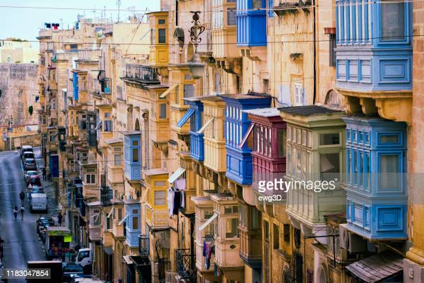 traditional closed wooden balconies in repubblika street, valletta, malta, europe - valletta stock pictures, royalty-free photos & images