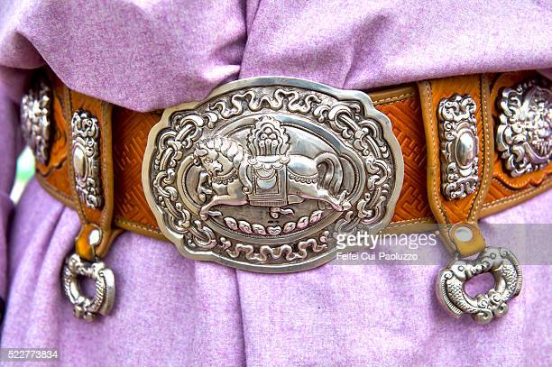 traditional clothing decoration for man at naadam festival at tsetserleg of arkhangai province in mongolia - silver belt stock photos and pictures