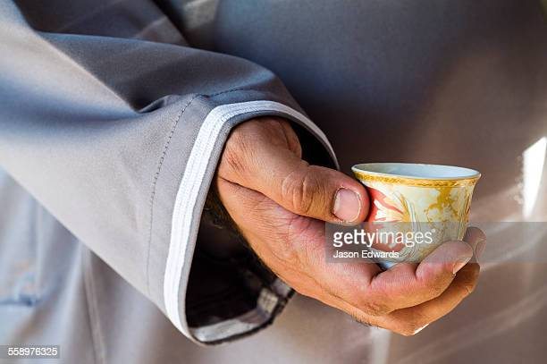 Traditional coffee, gahwa, is a hospitality ritual involving handleless cups.