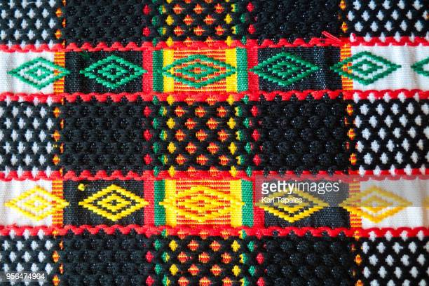 a traditional colorful clothing textile - woven stock photos and pictures