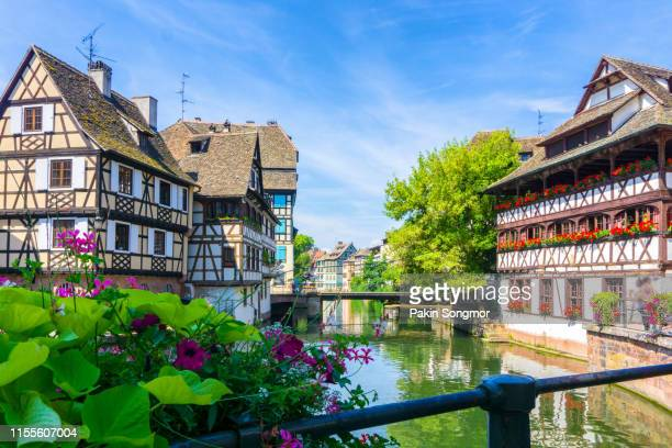traditional colorful houses in la petite france - ハーフティンバー様式 ストックフォトと画像