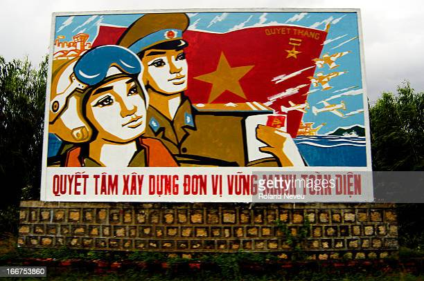 Traditional communist propaganda panel along the road outside Nha Trang in Central Vietnam..