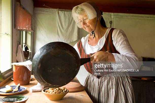 Traditional cooking and costumes in domestic kitchen Funen Ethnographic Village, Odense, Denmark