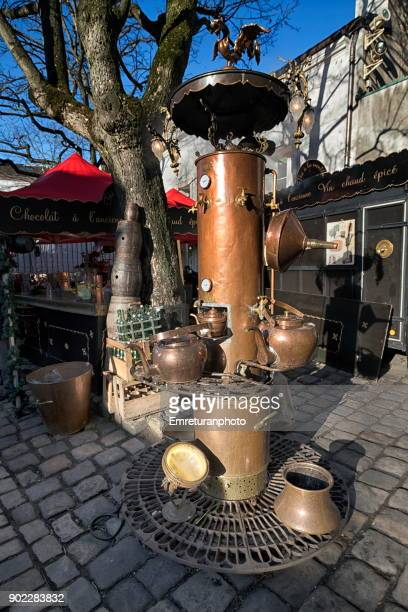 traditional copper heating stove in montmartre,paris. - emreturanphoto stock pictures, royalty-free photos & images