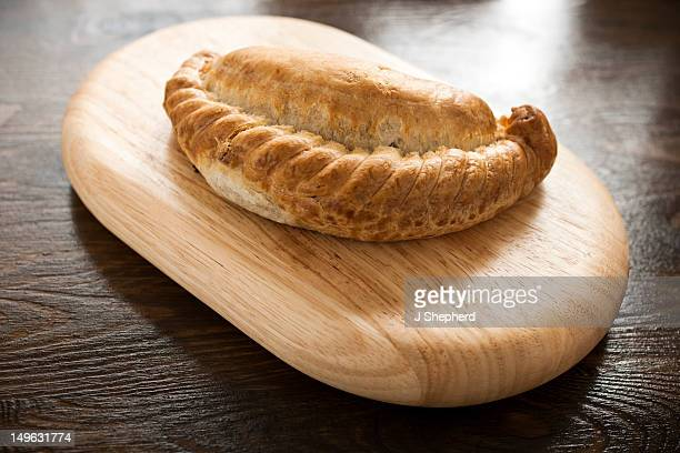 a traditional cornish pasty, made in cornwall - cornish pasty stock-fotos und bilder