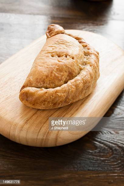 traditional cornish pasty, made in cornwall - cornish pasty stock-fotos und bilder