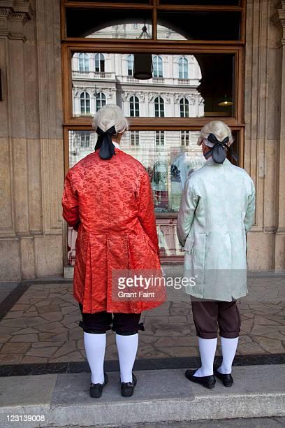 traditional costumed ticket sellers. - オーストリア文化 ストックフォトと画像