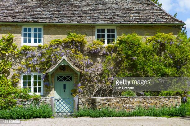Traditional Cotswold stone wysteriaclad cottage in the quaint village of Eastleach Turville in the Cotswolds Gloucestershire UK