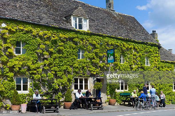 Traditional Cotswold vineclad pub in the picturesque village of Southrop in the Cotswolds Gloucestershire UK