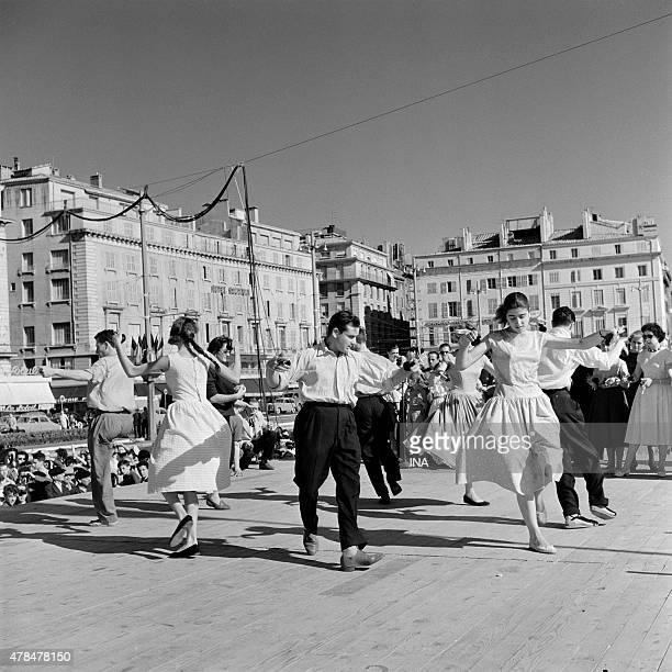 Traditional dance during folk festivals on the old harbor of Marseille