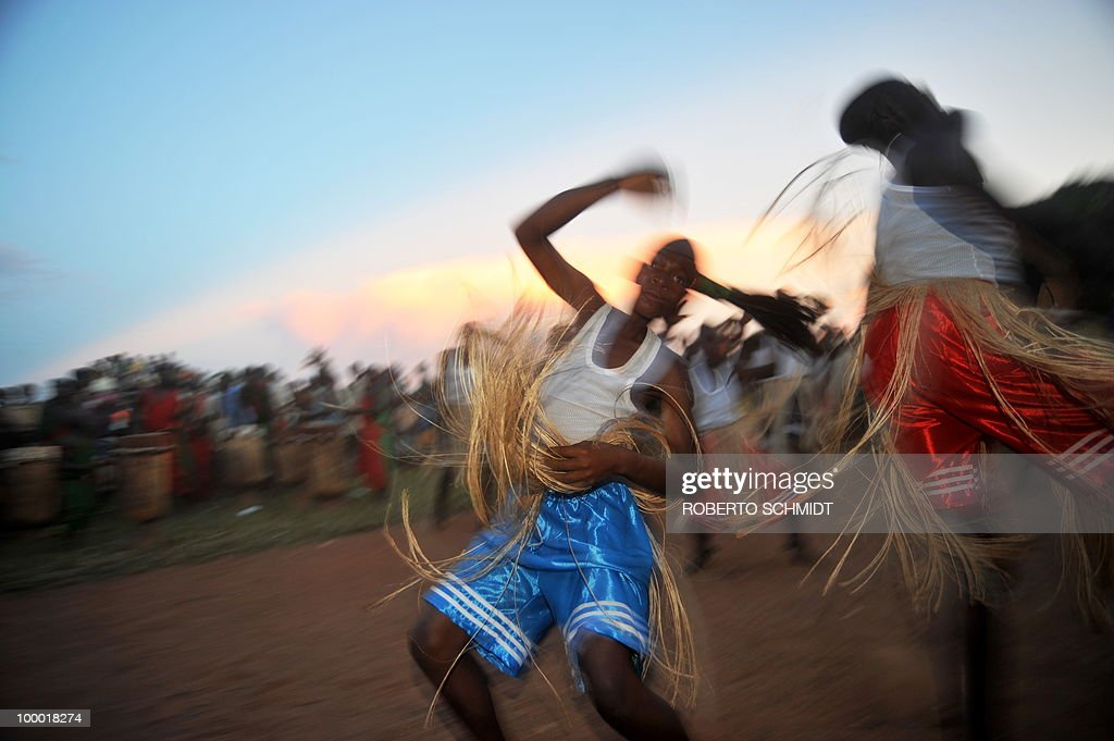 Traditional dancers girate as they perform during a political rally for opposition presidential candidate Agathon Rwasa, in the south western Burundian town of Nyanza-Lac on May 12, 2010. The small African nation of Burundi this week kicks off a tense electoral marathon in which former civil war foes will need to prove they can compete without jeopardising a fragile peace deal. About 3.5 million voters are called to the polling stations on Friday to elect local councillors in what observers argue is a key popularity test for the main contenders in upcoming legislative and presidential polls.