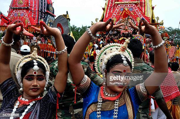 Traditional dancers of Shree Jagannath temple performing odissi dance near to the ditties chariots on the temple gods annual Bahuda Yatra festival or...