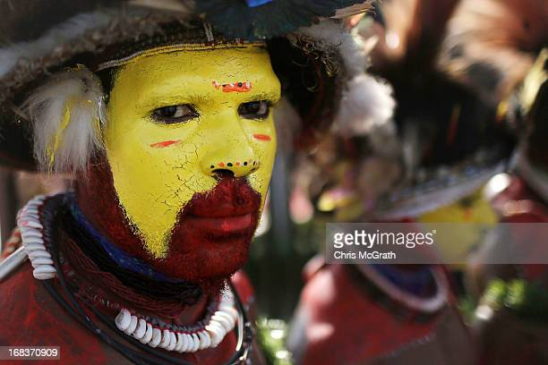 Traditional dancers perform ahead of the arrival of Australian Prime Minister Julia Gillard at Jackson International Airport on May 9 2013 in Port...