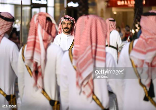 Traditional dancers perform at City Centre Mirdif to celebrate KSA National Day on September 23 2017 in Dubai United Arab Emirates