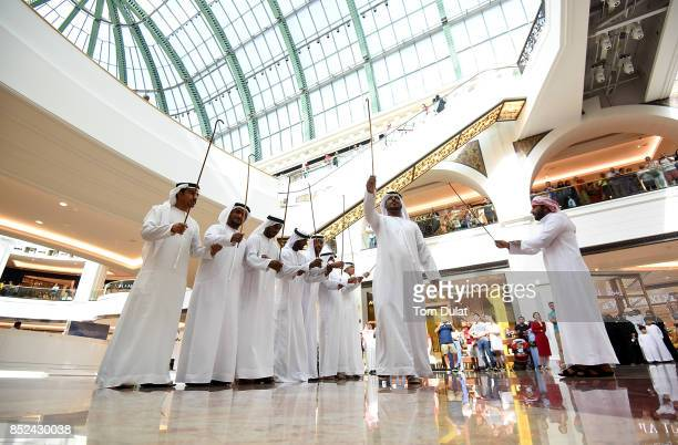 Traditional dancers perform at Mall of The Emirates to celebrate KSA National Day on September 23 2017 in Dubai United Arab Emirates