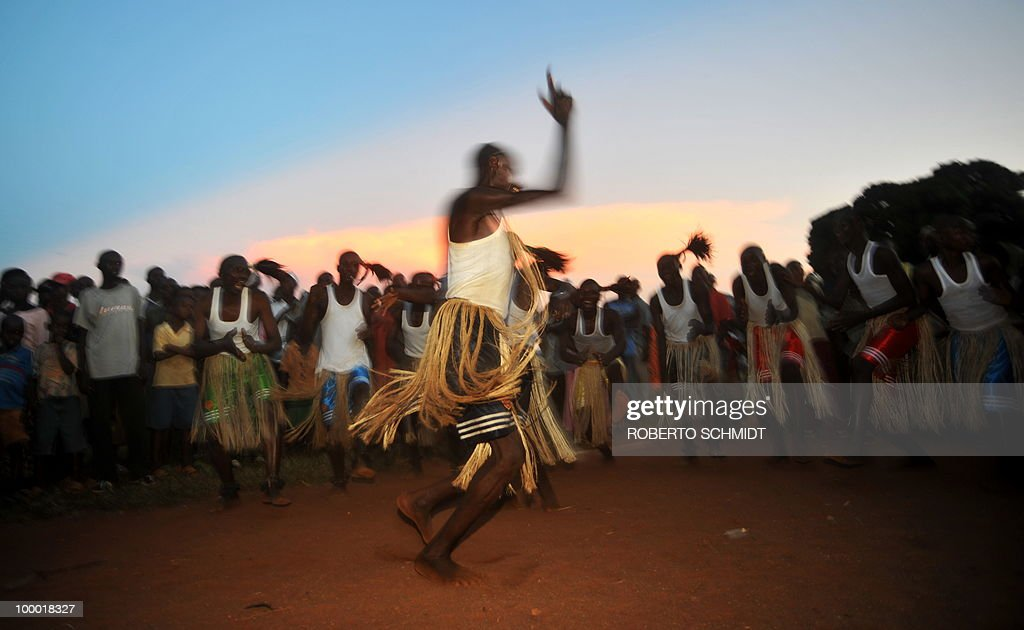 Traditional dancers perform during a political rally for opposition presidential candidate Agathon Rwasa, in the south western Burundian town of Nyanza-Lac on May 12, 2010. The small African nation of Burundi this week kicks off a tense electoral marathon in which former civil war foes will need to prove they can compete without jeopardising a fragile peace deal. About 3.5 million voters are called to the polling stations on Friday to elect local councillors in what observers argue is a key popularity test for the main contenders in upcoming legislative and presidential polls.
