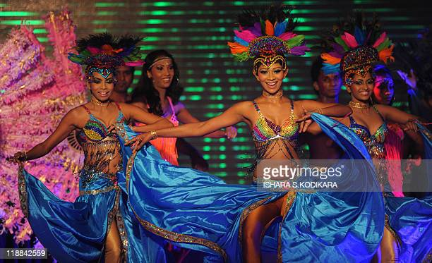 Traditional dancers perform during the Miss Sri Lanka contest in Colombo on July 11 2011 The winner will represent Sri Lanka at the Miss Universe...