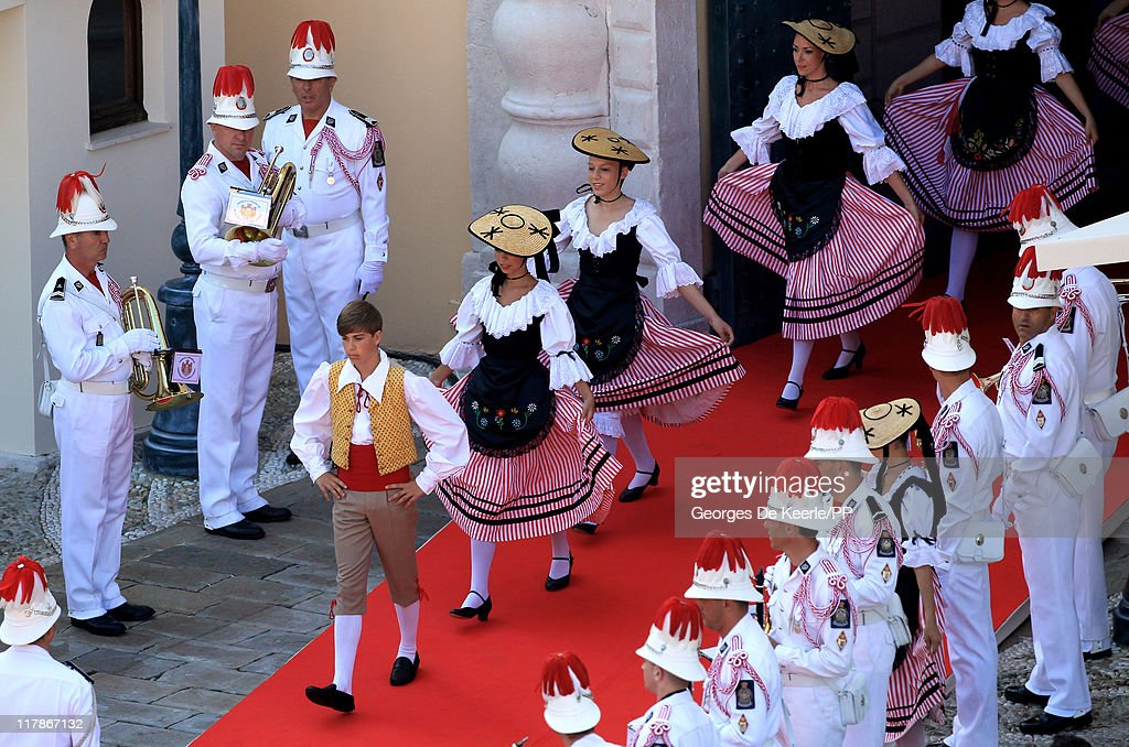 Traditional dancers walk out after the civil ceremony of the Royal Wedding of Prince Albert II of Monaco to Charlene Wittstock at the Prince's Palace on July 1, 2011 in Monaco. The ceremony took place in the Throne Room of the Prince's Palace of Monaco, followed by a religious ceremony to be conducted in the main courtyard of the Palace on July 2. With her marriage to the head of state of Principality of Monaco, Charlene Wittstock has become Princess consort of Monaco and gain the title, Princess Charlene of Monaco. Celebrations including concerts and firework displays are being held across several days, attended by a guest list of global celebrities and heads of state.