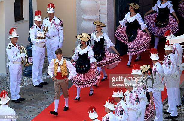Traditional dancers walk out after the civil ceremony of the Royal Wedding of Prince Albert II of Monaco to Charlene Wittstock at the Prince's Palace...