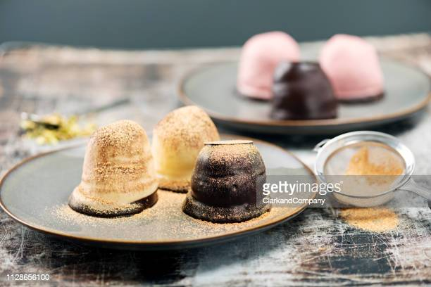 traditional  danish dessert, chocolate flødeboller. - danish culture stock pictures, royalty-free photos & images