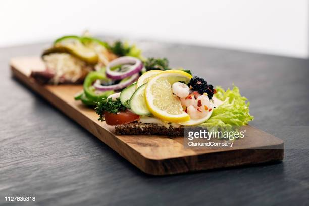 traditional danish open sandwich or smørrebrød - arenque imagens e fotografias de stock