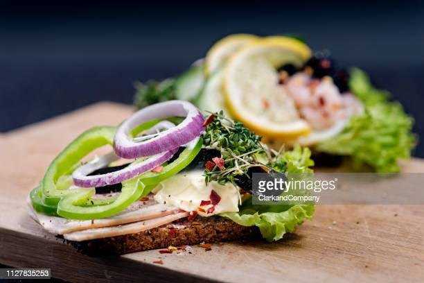 traditional danish open sandwichs or smørrebrød. - danish culture stock pictures, royalty-free photos & images