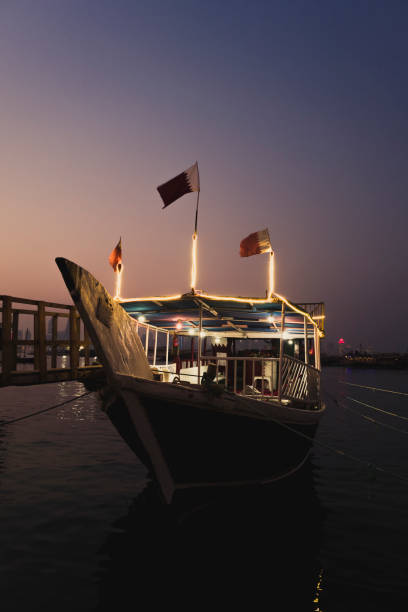 Traditional dhow boats docked at Doha's Corniche.